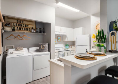 Kitchen and Laundry Room of an Apartment at Cadence at Southern University